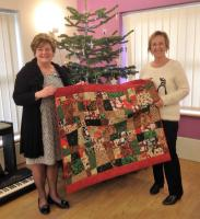 Quilt maker Mary Rawlins with Garden House Hospice's Helen Clark