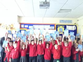 Pupils at Cwmfelinfach Primary School receive their dictionaries