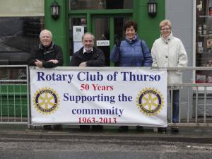 Club members with the Thurso banner in the town.