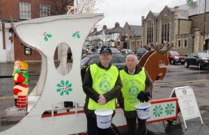Cold & Wet Rotarians on Santa's Sleigh collecting in the rain