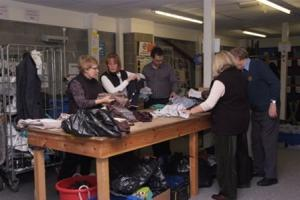 Sorting donations at the Dove House hospice warehouse
