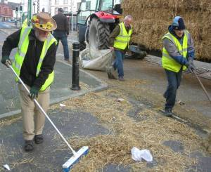 Members enjoying themselves clearing up after our Roll the Barrel event on Denbigh High Street on Boxing Day 2011 !