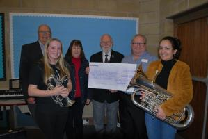 Andy Scott and Lauren Scott receiving the cheque from President Richard Hovey