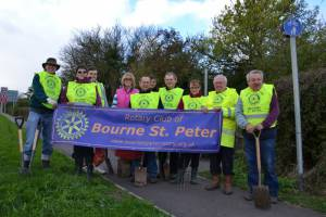 The team pose after planting 6 nets of daffodil bulbs on the grassed verges of Bourne By-Pass
