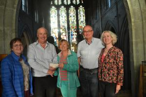 Pictured here with a cheque for £2,304 which was raised in aid of Cancer Research UK are Susie Barton, Rotarian Vic Clarke, Kay (Richard's wife), Barry Day and Clare Macourt.