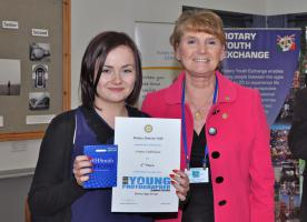 Aimie Catheline receiving her certificate and gift voucher from Jan Harris, the District Governor Elect.