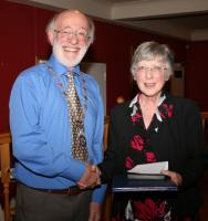 President Gordon Sanders presents Margaret Young with the Paul Harris Fellowship which was awarded to the late David Young shortly before he passed away.