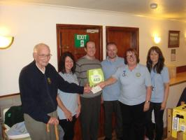 President Alun Moses and Rotarian Fred Davies Presenting �900 for a Defibrillator to members of Llanidloes First Responders Group.