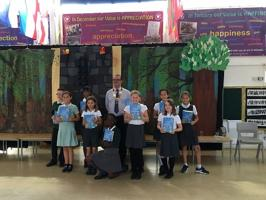 Presentation of Dictionaries to pupils at Micklands School