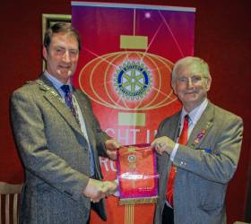 President of Rotary Club of Penicuik, Dave Anderson receiving a pennant from the District Governor Alistair Marquis.