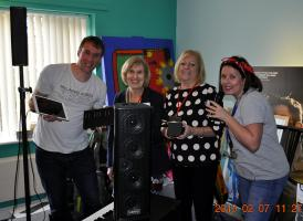 Music equipment funded by the club being handed over by President Enid and club members.