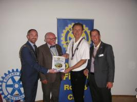 Presenting our banner to Rotary Dublin Fingal