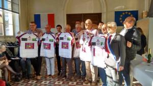 Club members displaying the rugby shirts of Bourgoin-Jallieu with the Mayor in the foreground.