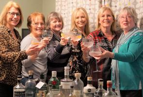 Wives and friends of the Ginfest organisers toast the success of the upcoming event with a foretaste of the featured gins.