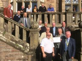 Making the presentation at Inglewood House, Alloa was Assistant Governor of District 1010 (Area 7) John Holme