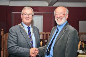 Gordon Sanders hands over the Presidency to Bill Munro