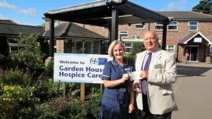Our picture shows David at Garden House with Jayne Dingemans, Director of Patient Care.