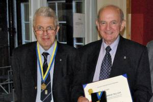 Harry Fisher presents Jim Paterson with the Paul Harris Fellowship