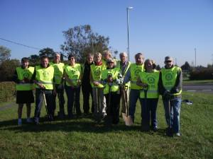 Bulb planting on the roundabout leading into Bourne from theToft and Stamford road on 15th October 2011.