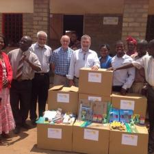 President Mike Kitchen presenting Boxes to a school in Malawi in 2015
