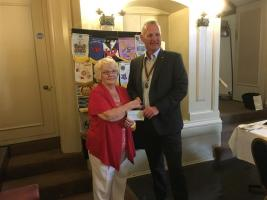 President Ian presents cheque