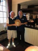 Winner this year Mike Hedges, presented with the Shield by last years winner Doug Nash