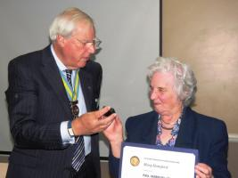 Mary Hansford receiving the Paul Harris Award from Asst DG Gerry Cowan