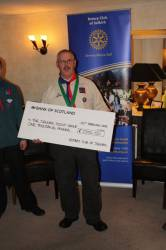 Scout Group Roof receive donation for Roof repairs