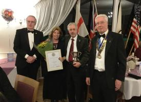Gerrie and Chris Bailey receive their Award from President Mike Clutton (right) and Rotarian Philip Jones (left)