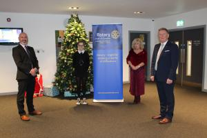 Baldragon Academy head teacher Hugh McAninch, pupil Imogen Robertson, Dundee City Chief Educational Officer Audrey May and Dundee Rotary Past President Robert Dunn