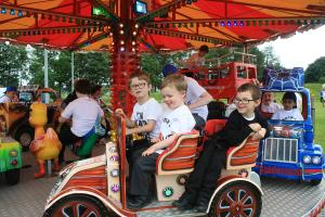 Kings Park school children enjoy a fairground ride at Rotary Kids Out