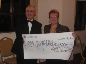 During the Christmas Dinner, the President Philippa handed a cheque for £500 to Ray James who was representing Wootton Bassett Age Concern