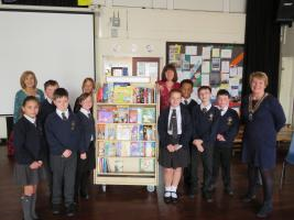 Book Trolley and 250 books donated by the club.