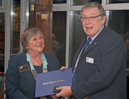 Rotary District Governor Joy Arnott presents John Biggs RCPR President his Paul Harris Fellowship award for his work on the Kop Hill Climb