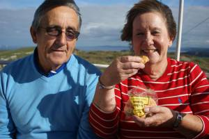 Julie and Rob, eating their cakes on top of the Great Orme.