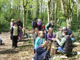 Children learning woodcraft in Angus Wood