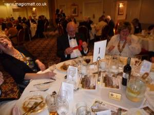 Astounded Rotarians collapse with laughter.