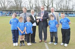 President John Hawkins presents a cheque for £750