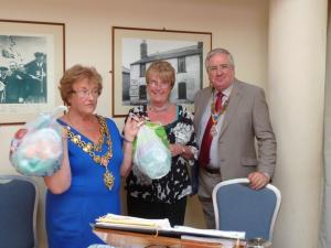 The Mayor with bags of bottle-tops