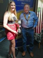 "Award Winner – Niamh is pictured being presented with the Wilf Ainscow ""Ranger"" Trophy by John Cooper, President of Bury Rotary Club"