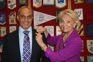 The photograph shows Nitesh being presented with his badge by Wendy.