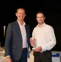Individual winner Stuart Fromant is presented with his trophy by Immediate-Past President Martin Stibbards