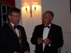 Stephen Walls receives the President's jewel form ougoing President Phil Tanner