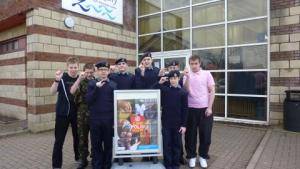 Queensferry Sea Cadets at a previous Swimarathon saying we are this close to ending polio.