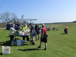Walkers receiving sausages in bread roll and drinks at halfway on long route