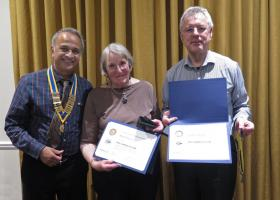 President Mukesh Patel presents Mary Perren and Andrew Picken with their awards