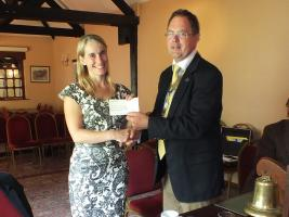 President Chris Whipps Presenting cheque to 'Nelson's Journey'