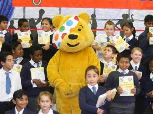 Pudsey Bear awards Dictionaries to children of St Mary's school