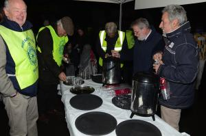 Chris Sexton (right)one of our Friends helping us serve mulled wine at the switching on of the lights on the Wilton Christmas Tree.
