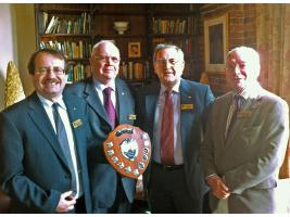 Stephen Thomas, David Gordon, David Davies and Don Howard (Oswestry's winning team in 2012) take a last look at the District Quiz Area Trophy.